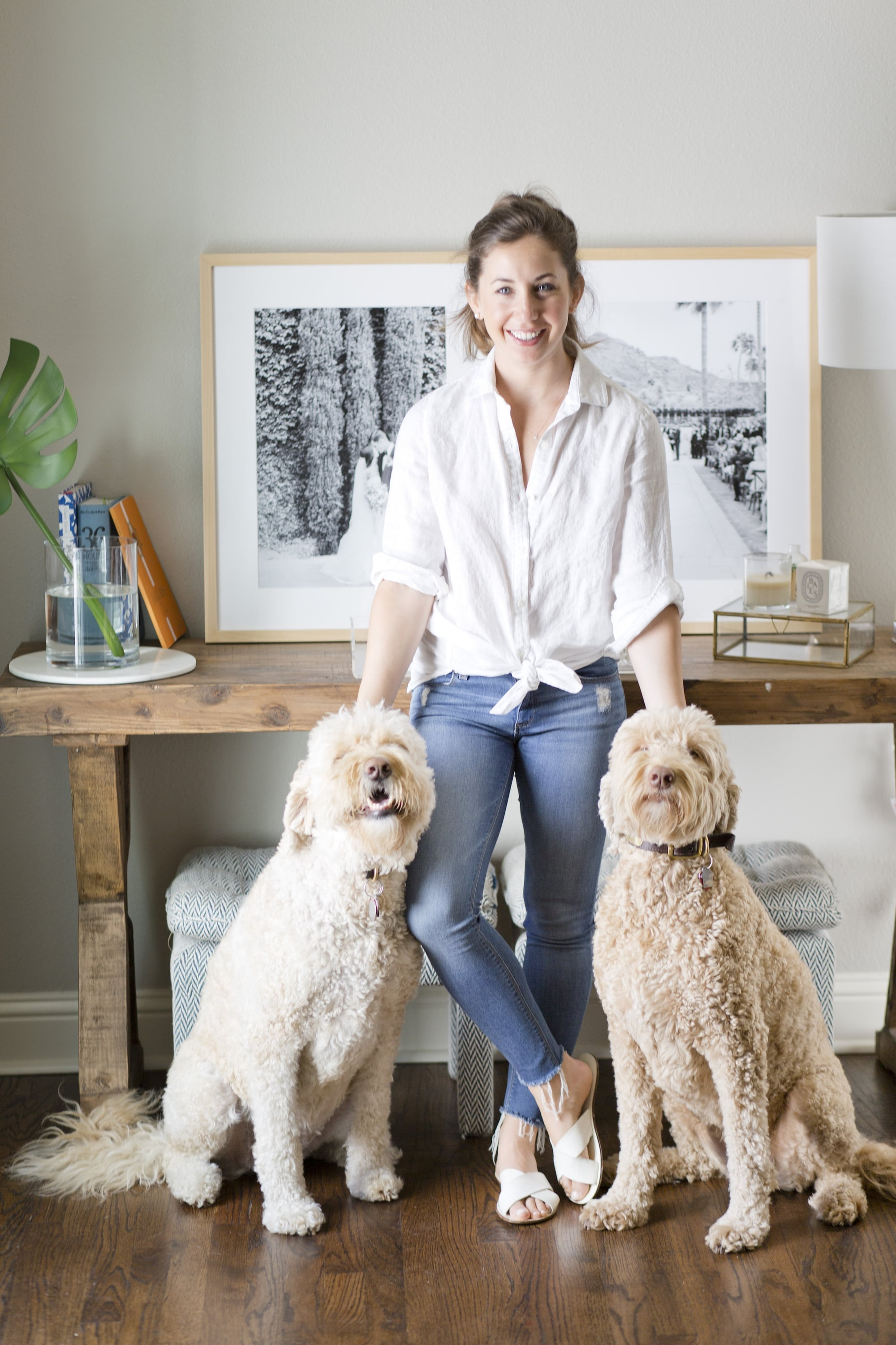 Ali Leigh in White Shirt and Jeans with Goldendoodles