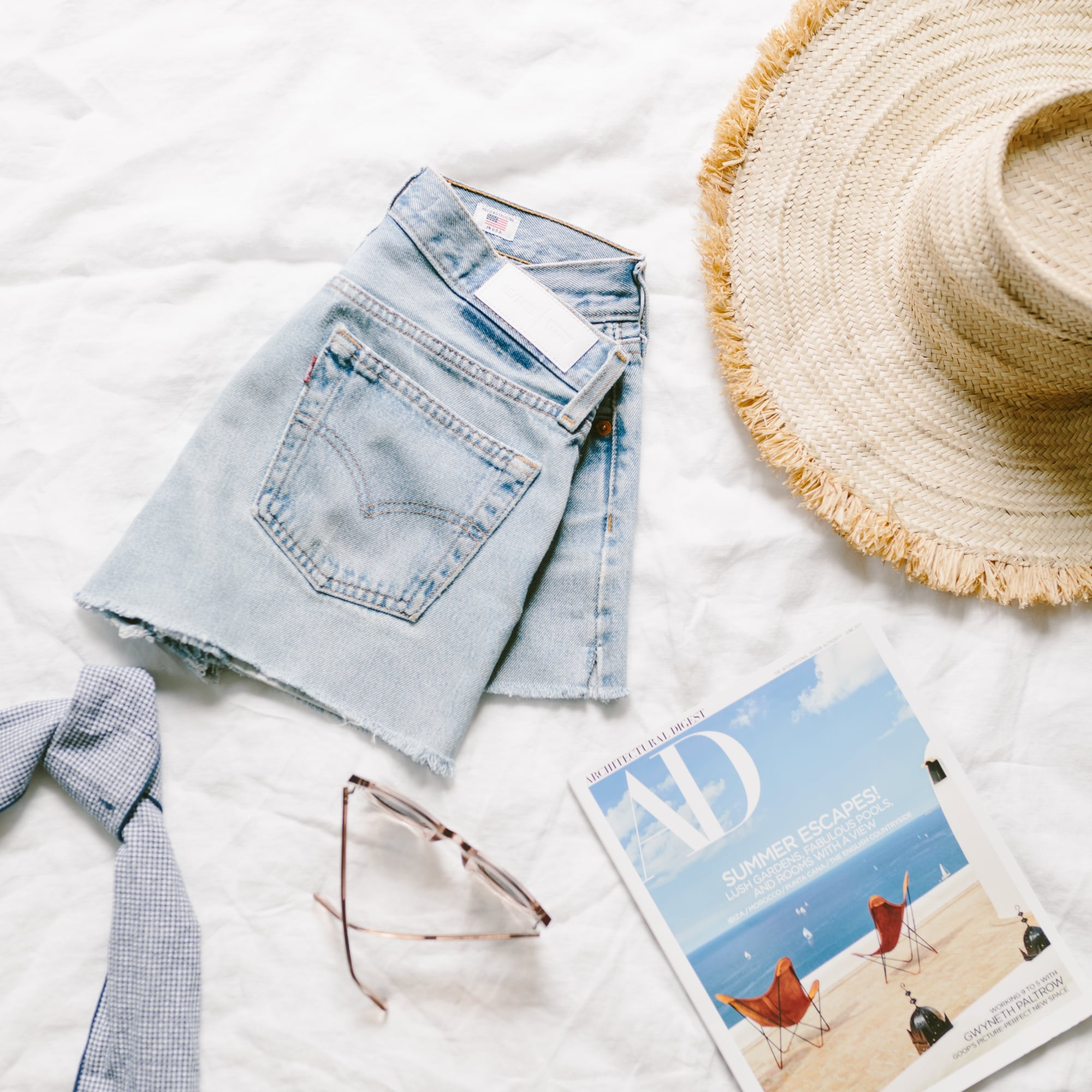 Levis, Sunglasses, Straw Hat and Architectural Digest