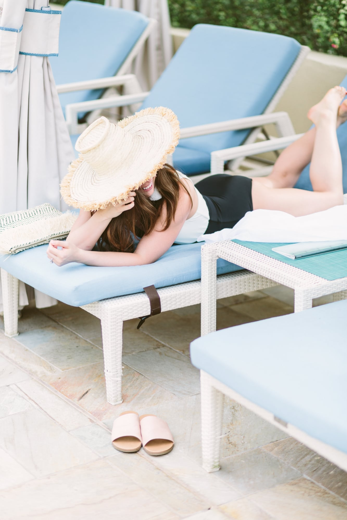 Poolside wearing Solid and Striped Swimsuit and Indego Africa Hat
